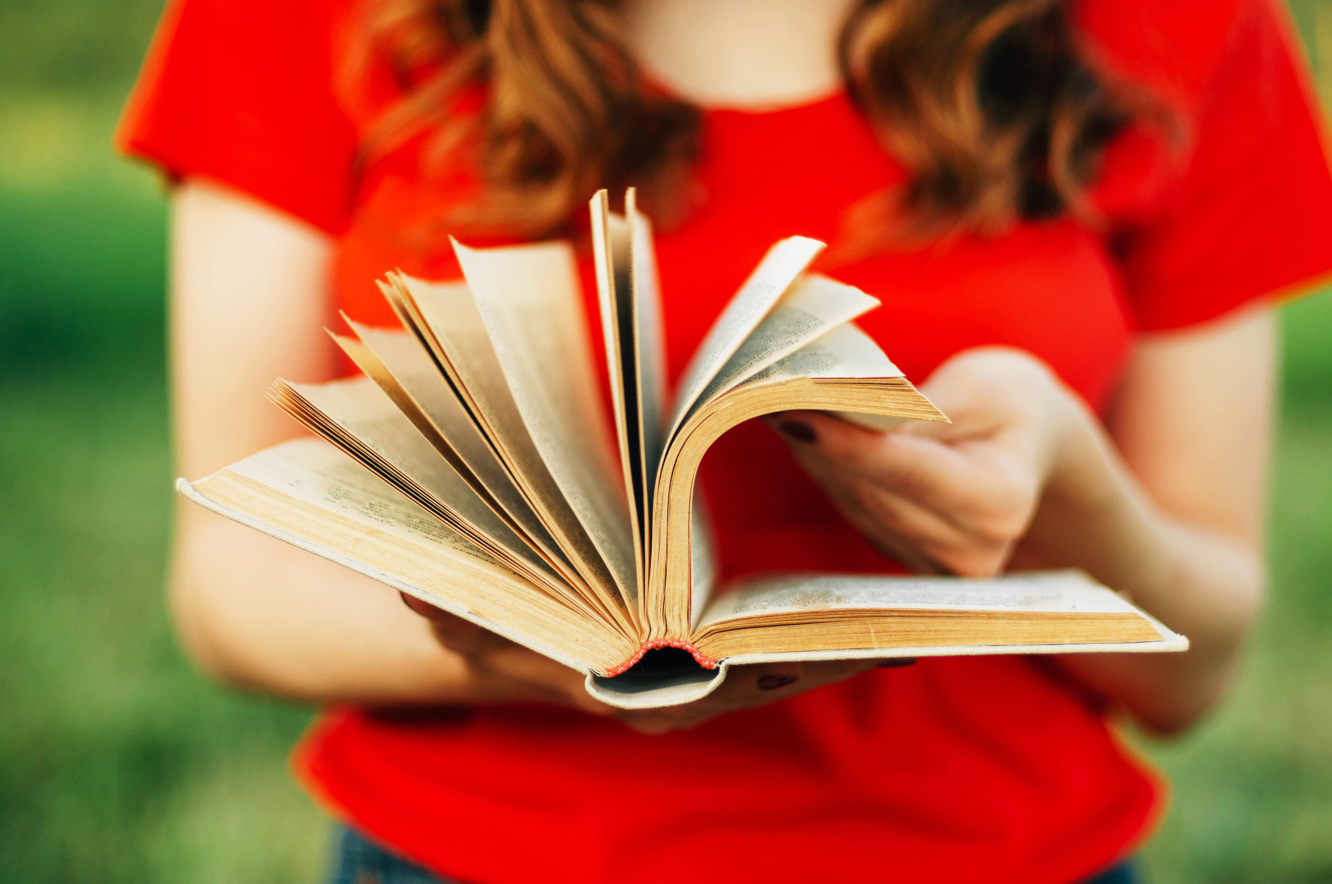 bigstock-Detail-From-A-Woman-Reading-A--137615903.jpg