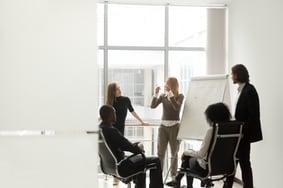 bigstock-Diverse-Business-Team-Listenin-229505110