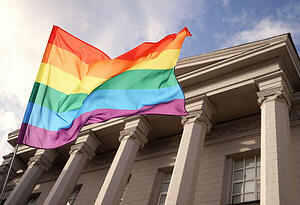bigstock-Waving-gay-flag-and-courthouse-196592812 (1)